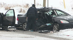 Police at scene of deadly fatal car accident and crash scene in snowstorm Stock Footage