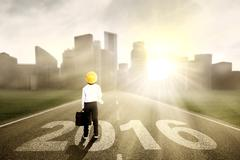 Little boy on the road with numbers 2016 Stock Photos