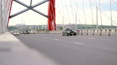 Road through the bridge with cloudy sky and moving cars. Changes focus from Stock Footage