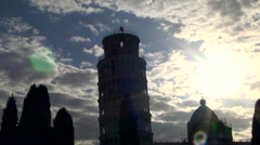 Backlit shot of Piazza dei miracoli near Pisa tower, in a cloudy sky. Stock Footage
