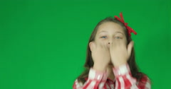 Girl sends blow  kiss on a green screen Stock Footage