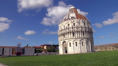 Fast motion of Pisa baptistery on a green lawn under a cloudy sky. - stock footage