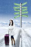 Woman with winter destination vacation choices Stock Photos