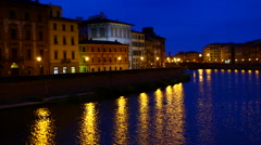 Arno river and Pisa at night with street lamps. Stock Footage