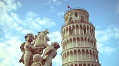 Locked down shot of Pisa leaning tower and a statue about OPA. Stock Footage