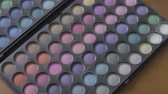 4K S-log 2 fake eyelashes placed on multicoloured eyeshadow pallet - stock footage