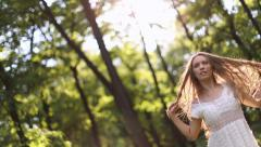 sexy girl in white dress dancing in the forest - stock footage