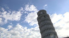 From the bottom backlit shot of Pisa leaning tower under a cloudy sky. Stock Footage