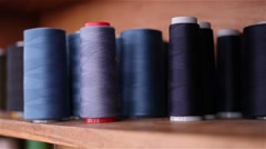 several blue wool rolls for sewing - stock footage