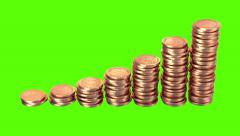 Growing Coins on a Green Background Stock Footage