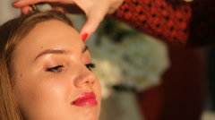 makeup artist teaches girls to paint brows - stock footage