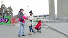Young family with a child walks in the street Stock Footage