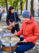 Male performance of street musicians Stock Photos