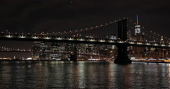 New York City night downtown skyline boat sailing view Stock Footage