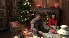 Stock Video Footage of mother and the father prepare gifts for Christmas and receive kind SMS