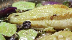 Cooking fish fillet in frying pan Stock Footage