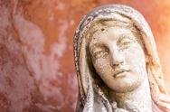 Stock Photo of portrait of a weathered maria sculpture
