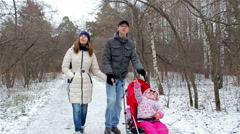 Young family with a child walks in the street - stock footage