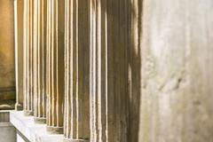 detail of some ancient pillars of a temple - stock photo