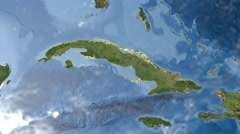 Night to day - rotating Earth. Zoom in on Cuba outlined - stock footage