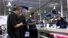 Windows worker explaining questions for old man inside Best buy store Stock Footage