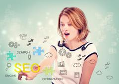 Woman activating an SEO interface - stock photo