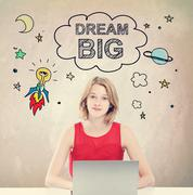 Dream Big concept with young woman with laptop Stock Photos