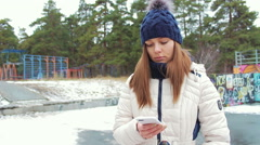 Beautiful young mother with a smartphone Stock Footage