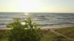 Sunset along lake shore during summer time - stock footage