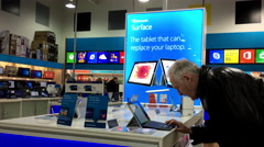 Old man tring new computer inside Best buy store Stock Footage