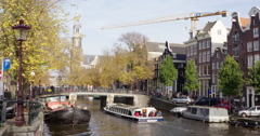 Amsterdam Sightseeing boat at canal  4K Stock Footage