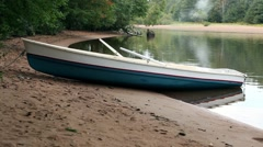 Beautiful landscape with a rowing boat on the beach Arkistovideo