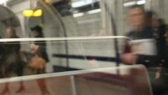 Reflexion into the metro carriage of people waiting at the metro stop in Paris. Stock Footage