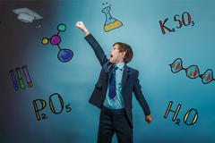 Stock Photo of teacher boy chemistry teenage student businessman superhero info
