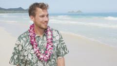 Happy Man Walking On Hawaiian Beach Wearing Flower Lei on Hawaii Stock Footage