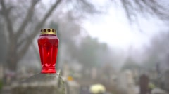 Red candle holder at the top of a headstone 4K - stock footage