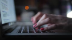 Female hands with manicure typing text on laptop at night Stock Footage
