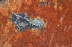 Bright rust stained corroded metal surface - stock photo