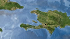 Night to day - rotating Earth. Zoom in on Haiti outlined - stock footage