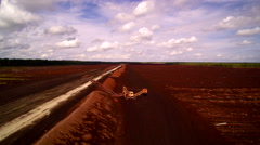 The wide peat field with brown soils on it Stock Footage