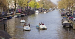 Amsterdam canal with pedal boats, Netherlands Stock Footage