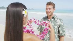 Woman Putting Garland Around Man's Neck At Beach – Traditional Hawaii Culture - stock footage