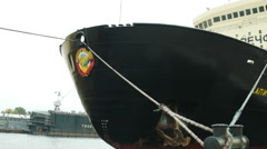 Soviet Hammer and Sickle emblem on a black ship in Russia Stock Footage