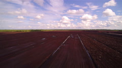 The peat field with the bue sky and white clouds - stock footage