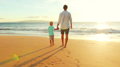 Father and Son Bonding Together at the Beach at Sunset. - stock footage
