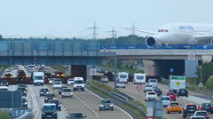 Airplane over autobahn - stock footage