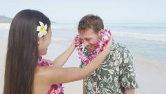 Couple Enjoying Their Vacation On Hawaiian Beach - Traditional Hawaii Culture - stock footage