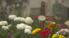 Wooden cross and flowers in the cemetery 4K Stock Footage