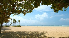 Beautiful and Nearly Deserted Tourist Beach in Bali, Indonesia Stock Footage
