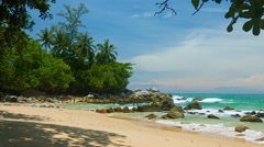 Tourists Enjoying an Exotic Tropical Beach with Boulders and Trees Stock Footage